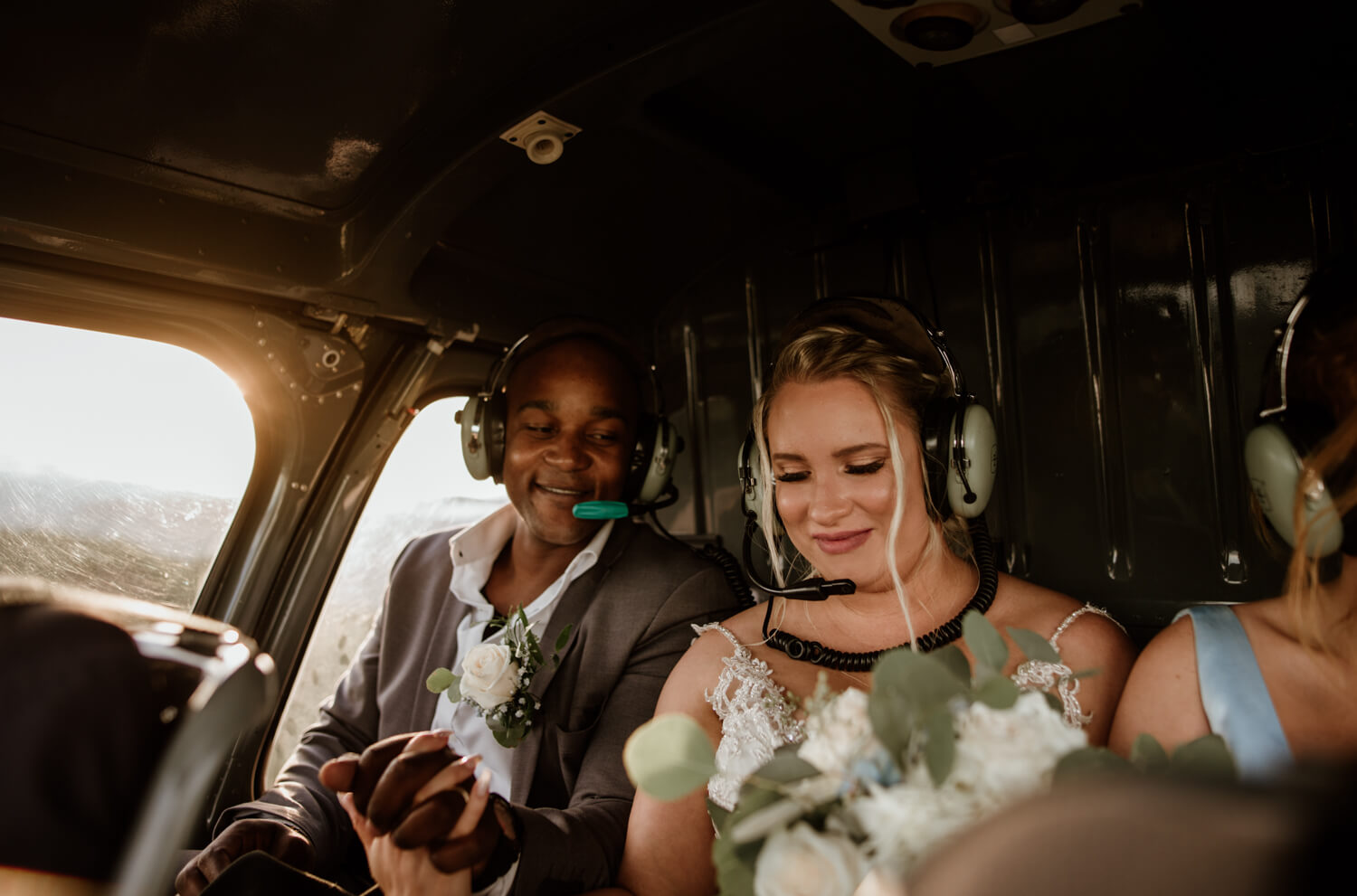 bride and groom in the helicopter