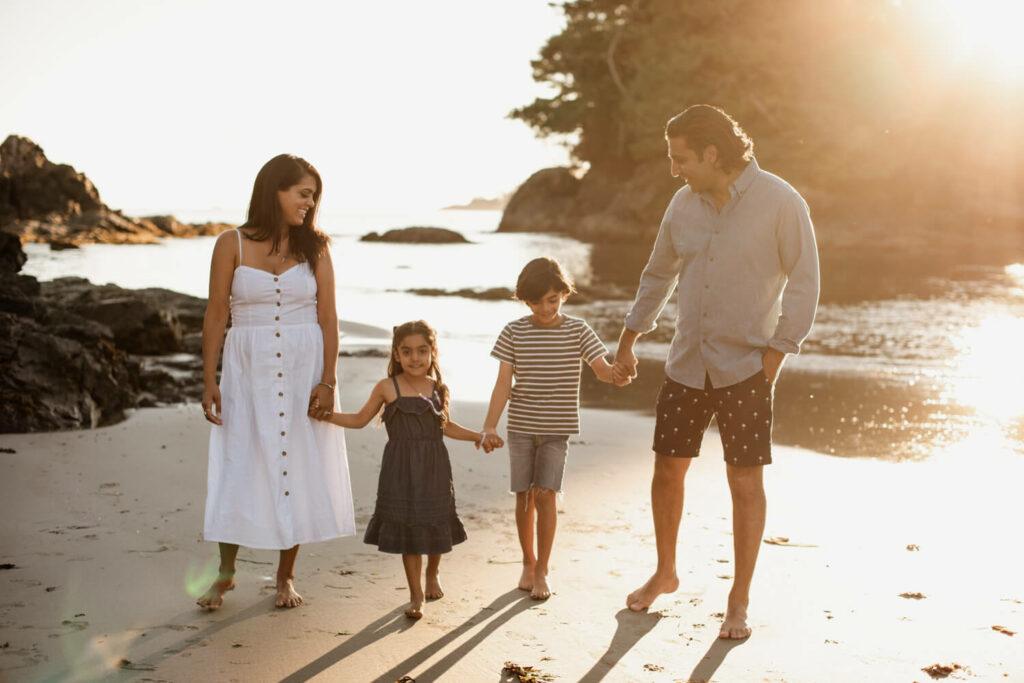family walking down mackenzie beach in tofino