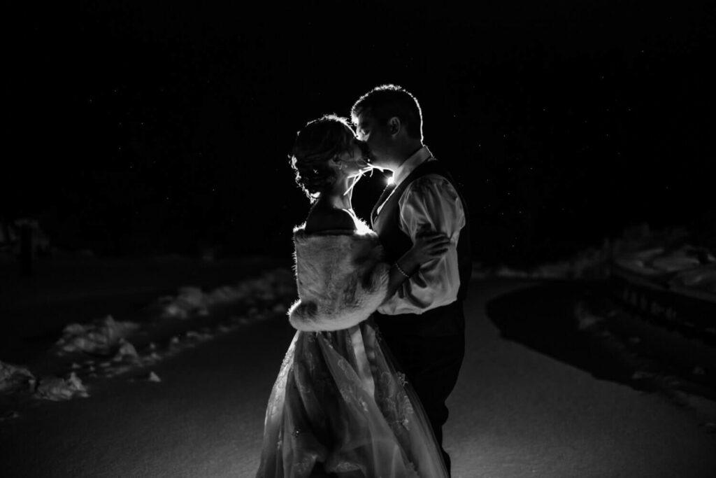winter wedding night portraits of bride and groom